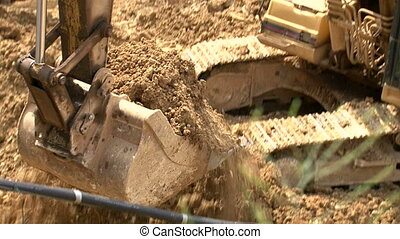 Bulldozer Filling Dump Truck - Shots of civil works...