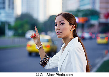 latina businesswoman calling taxi car leaving work - Latin...