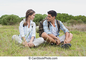 Couple taking a break on landscape - Young couple taking a...