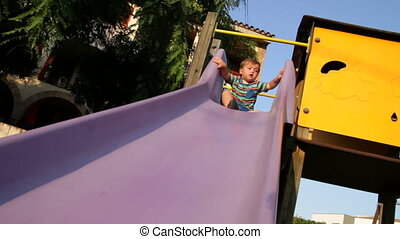 Baby Toddler in the Park Slider 01 - Child playing in the...