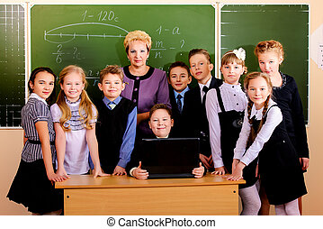 grade school - A teacher and her students at school...
