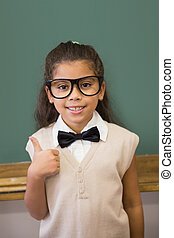 Cute pupil dressed up as teacher in classroom at the...