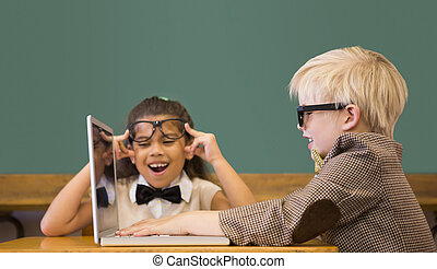 Cute pupils dressed up as teachers in classroom at the...