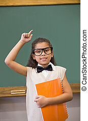 Cute pupil dressed up as teacher in classroom
