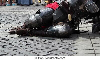 Fallen Knight Rises - On a battle a fallen heavy armored...