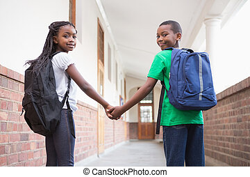 Pupils holding hands in corridor - Cute pupils holding hands...