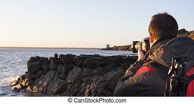 Young adult photographing - Young photographer in the...