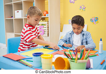 Cute little boys making art in classroom