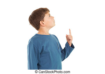 Cute little boy pointing up on white background