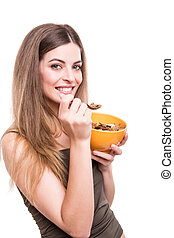 Women eating cereals - Beautiful young woman eating cereals...