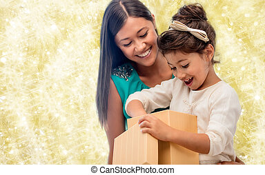 happy mother and child girl with gift box - christmas,...