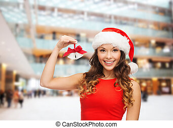 smiling woman in santa helper hat and jingle bells -...