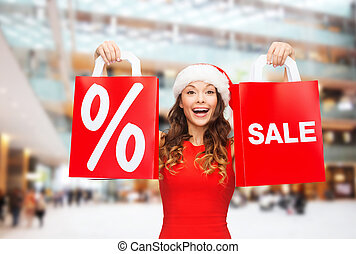 woman in red dress with shopping bags - sale, gifts,...