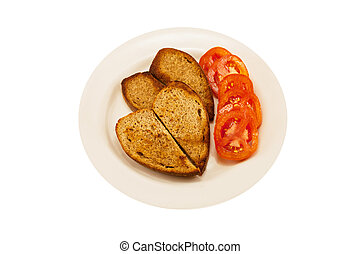 two heart-shaped toast and tomato - white plate with two...