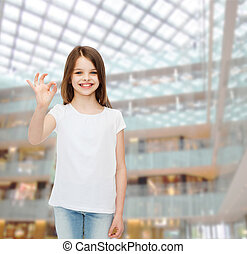 smiling little girl in white blank t-shirt - advertising,...