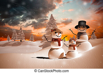 Composite image of snow family against orange and blue sky...