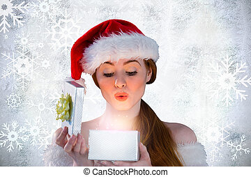 Composite image of sexy girl in santa costume opening a gift...
