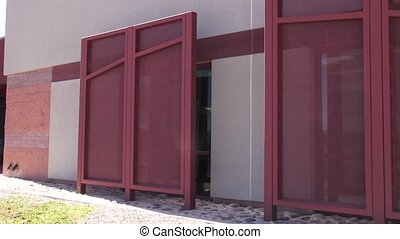 Sun Shades in Front of Windows - Large red sun shades...