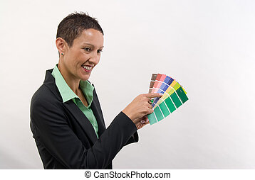 female looking at color charts