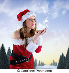 Composite image of sexy santa girl blowing over hands - Sexy...