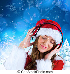 Composite image of sexy santa girl listening to music - Sexy...