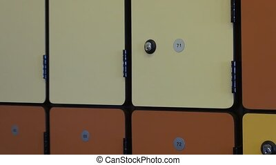 Multicolored Lockers, Locker Room - A wall of multicolored...