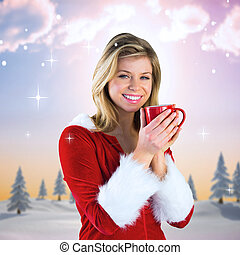 Composite image of pretty santa girl holding mug - Pretty...