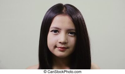 Asian teen looking at camera, girl