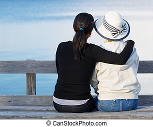Mother and Daughter enjoying their time at the lake -...