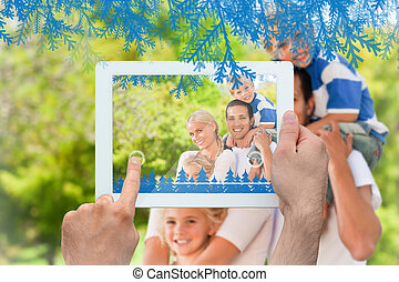 Composite image of hands holding tablet pc