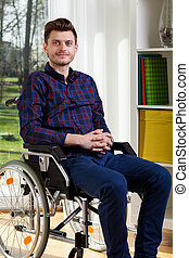 Young man on wheelchair - Portrait of young man on...