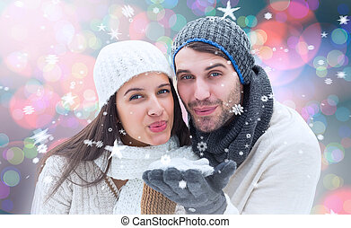 Composite image of young winter couple - Young winter couple...