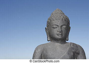 buddha - A dark statatue of buddha made of stone