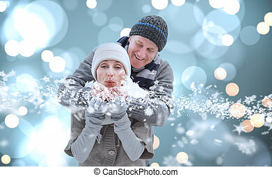 Image of mature winter couple - Mature winter couple against...