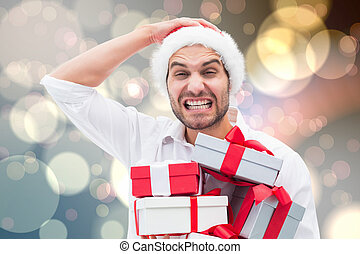 Composite image of festive man holding christmas gifts -...