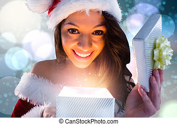 Composite image of sexy santa girl opening gift - Sexy santa...