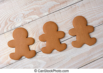 Three Gingerbread Cookies Undecorated - HIgh angle view of...