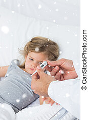 Composite image of doctor holding thermometer with ill girl in h