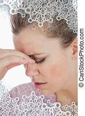 Composite image of young woman suffering from headache -...