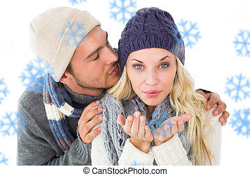 Composite image of attractive couple in winter fashion -...