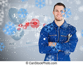 Composite image of portrait of a young mechanic next to...