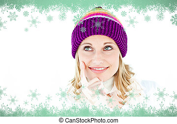 Composite image of pensive woman with a colorful hat -...