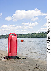 Lifeguard Equipment - Lifeguard buoy in sand next to river