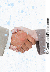 Composite image of side view of shaking hands closing a deal