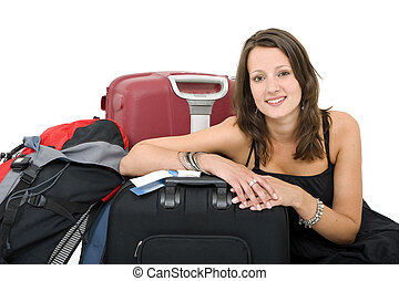 Travelling woman - Young brunette posing amidst her luggage,...