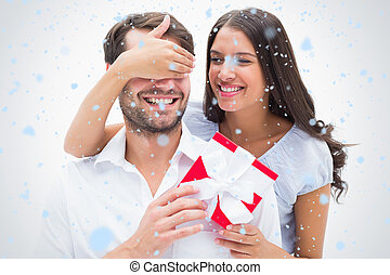 Composite image of pretty brunette surprising boyfriend with...