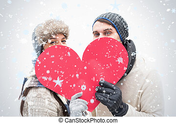 Composite image of attractive young couple in warm clothes...