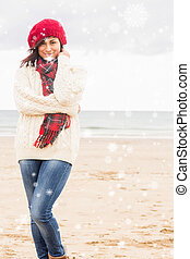 Composite image of cute smiling woman in stylish warm...