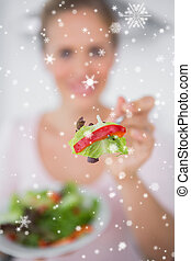 Composite image of woman with salad dish - Woman with salad...