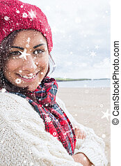 Composite image of woman in knitted - Woman in knitted hat...